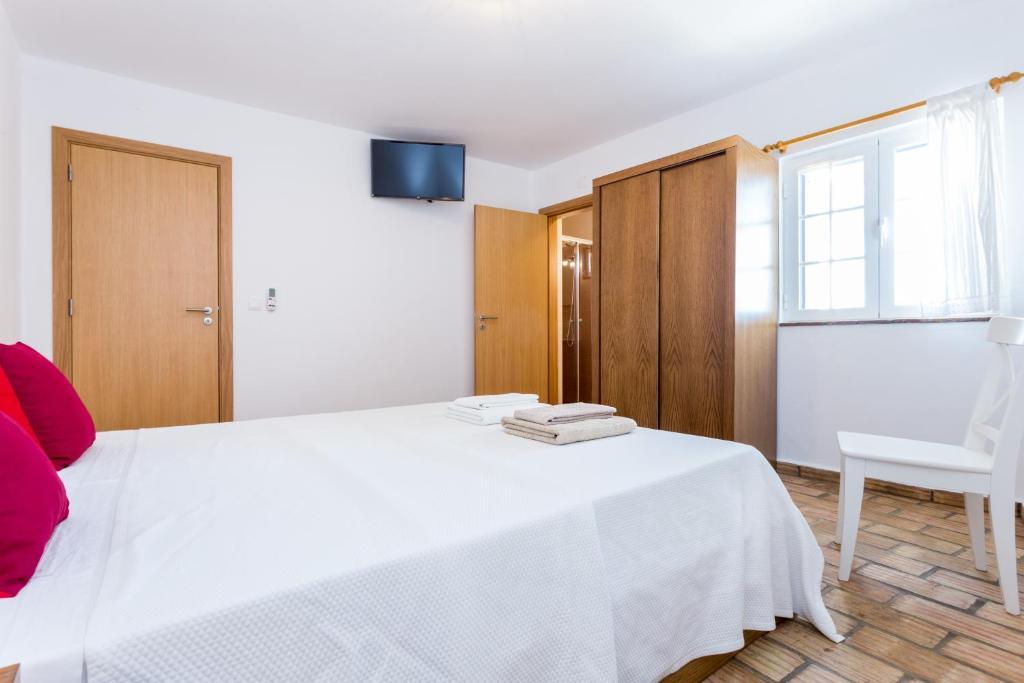 A bed or beds in a room at Mértola Natural - Monte da Eirinha