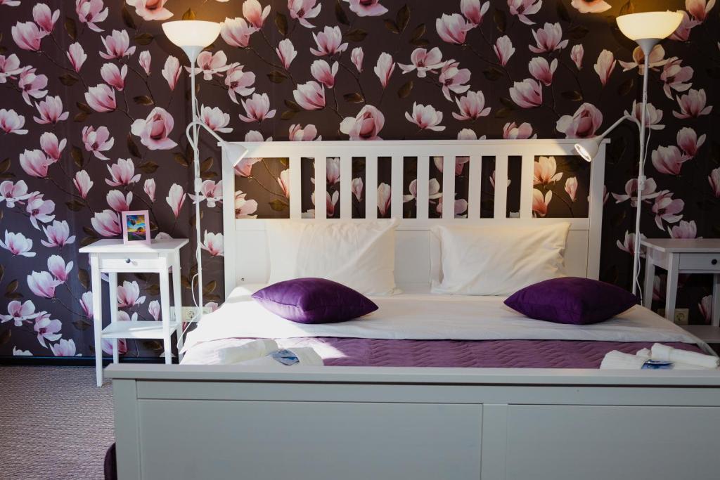 Кровать или кровати в номере Sleep House Рязань