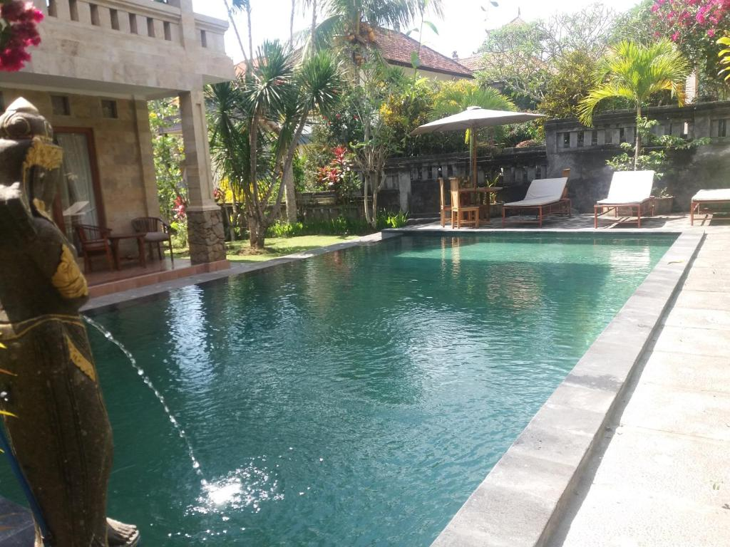 The swimming pool at or near Dewi Ayu Accommodation