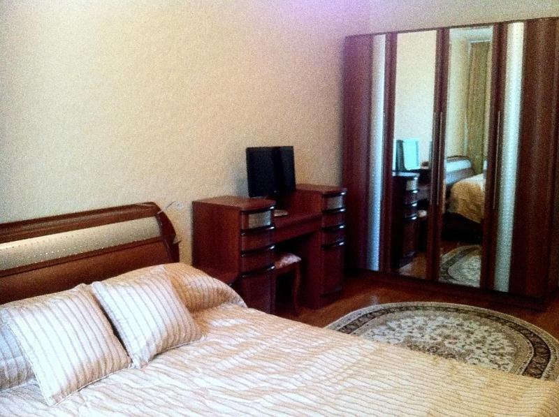 A bed or beds in a room at Mini Hotel Andol