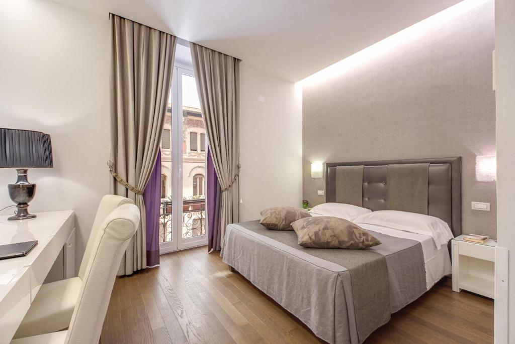 A bed or beds in a room at Roma Boutique Hotel