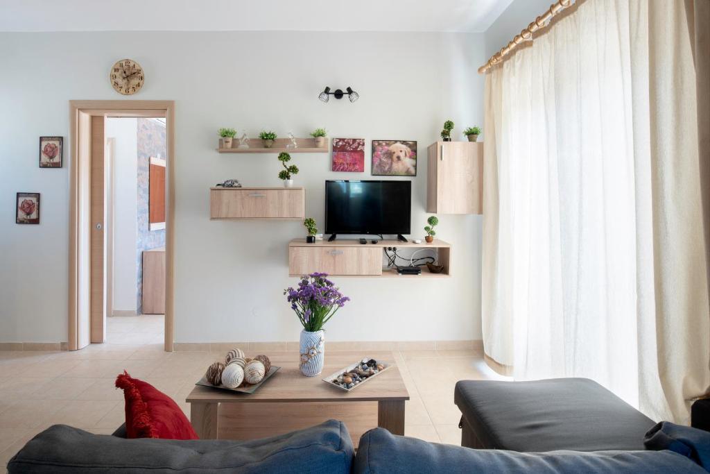 Telewizja i/lub zestaw kina domowego w obiekcie Stergio's Apartment