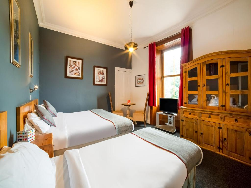 A bed or beds in a room at The Hillside Hotel
