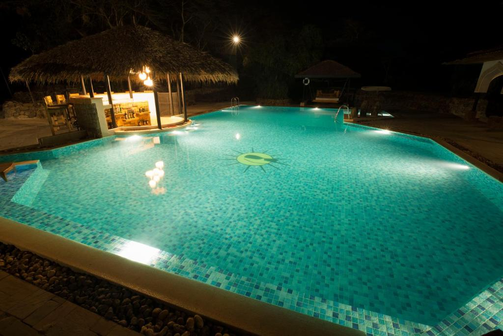 The swimming pool at or close to Small World Country Club