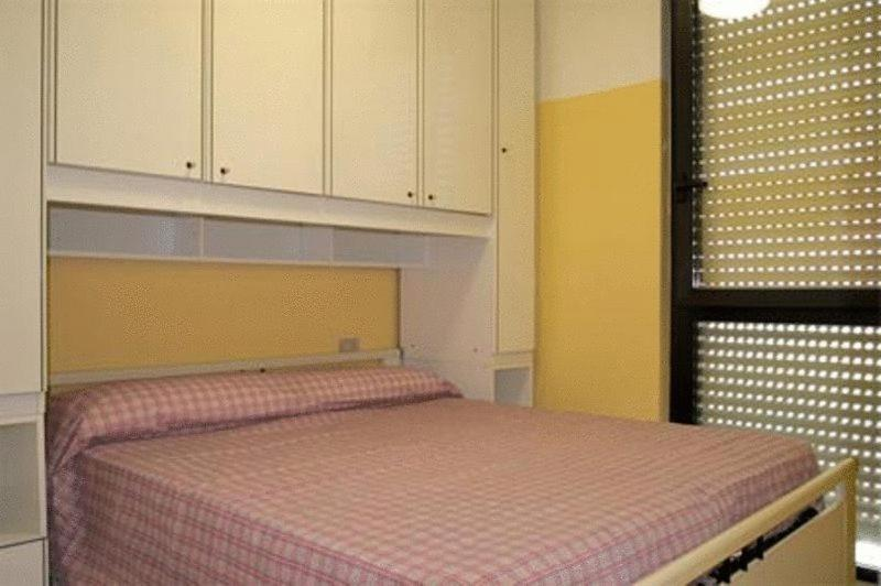 A bed or beds in a room at Residence Nettuno