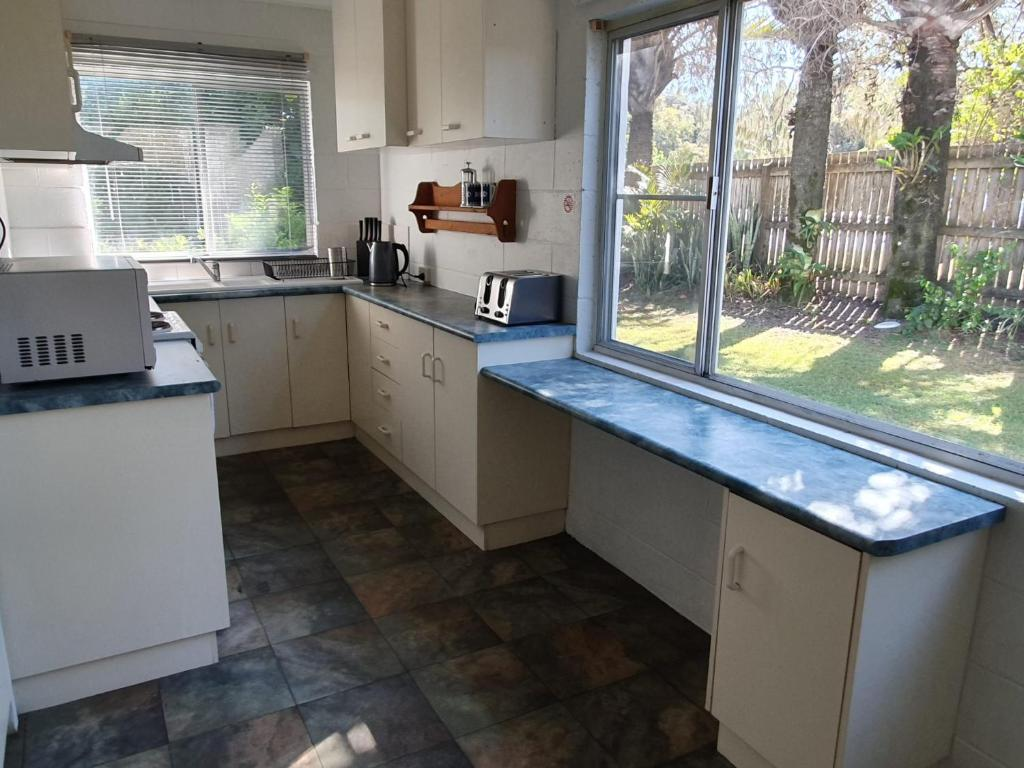 A kitchen or kitchenette at 1 Spectrum Street, Rainbow Beach- Close to shops and main beach