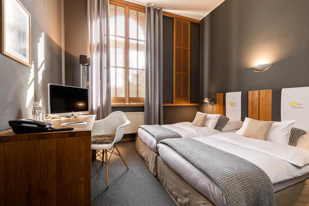 A bed or beds in a room at YoHo - The Young Hotel