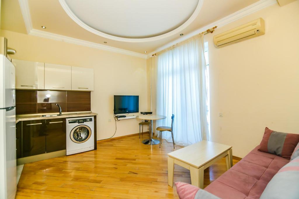 Uma área de estar em Apartment in Boulevard