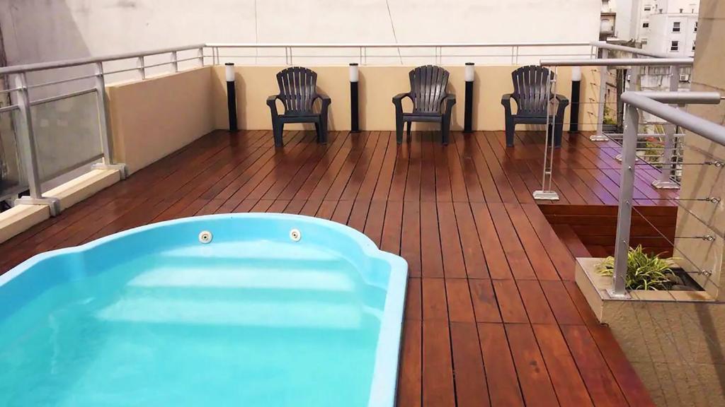 La pileta dentro o cerca de Gorgeous Studio with rooftop pool, gym and laundry - Corrientes Ave