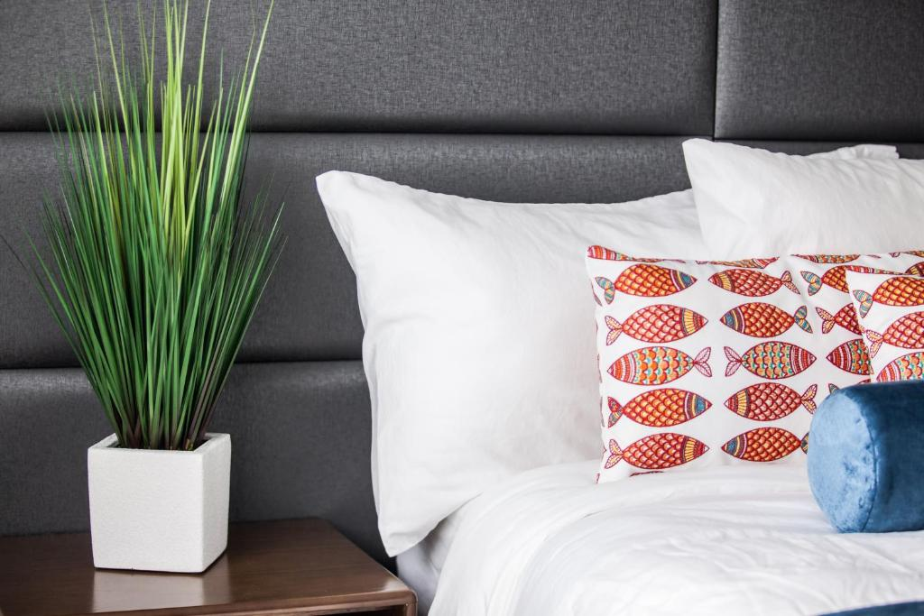 A bed or beds in a room at The Elmar Boutique Hotel