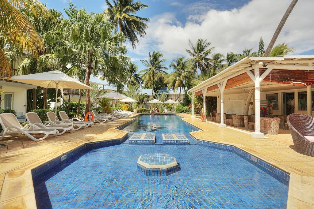 Piscine de l'établissement Cocotiers Hotel – Mauritius ou située à proximité