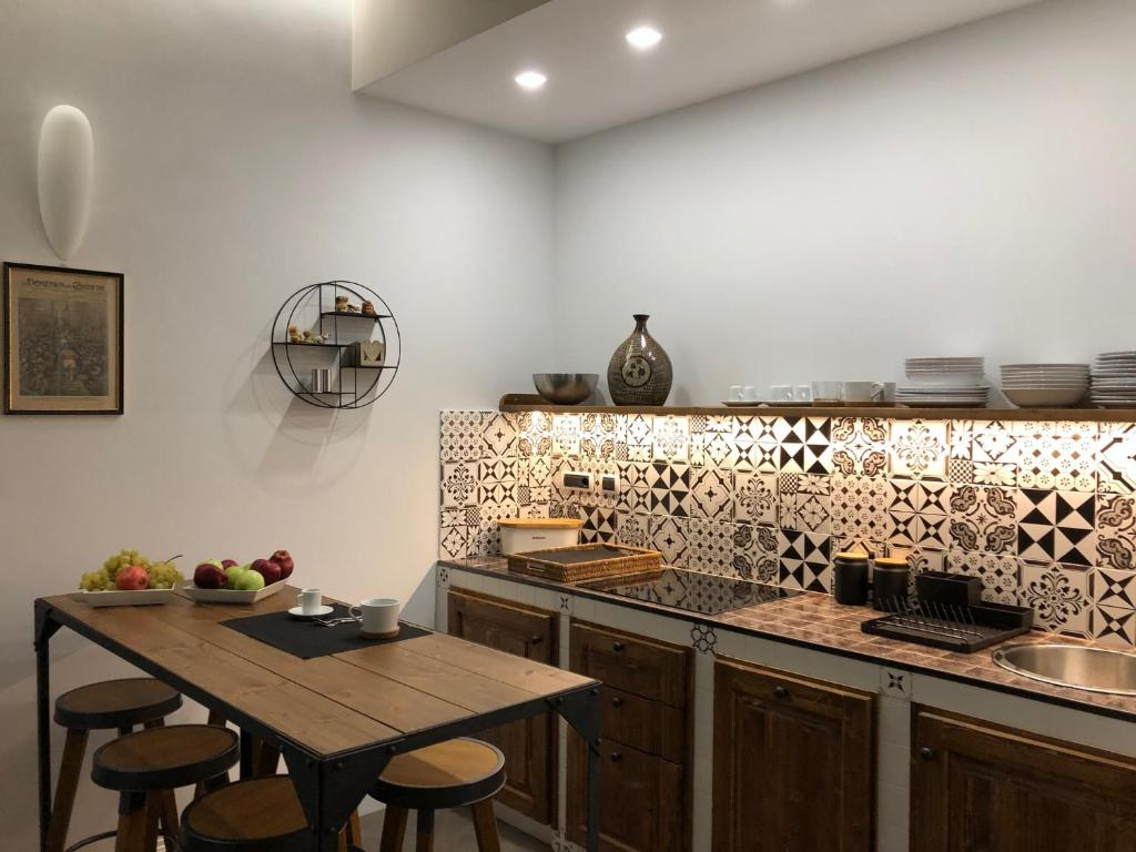 A kitchen or kitchenette at principati17