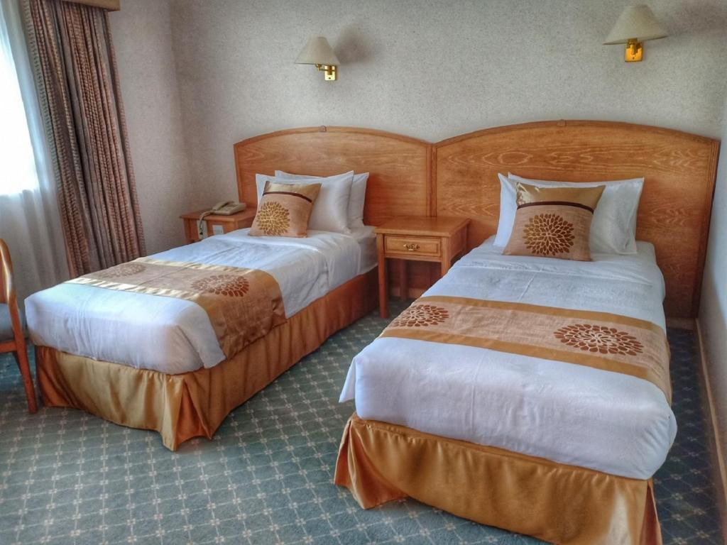 A bed or beds in a room at Terrace Hotel