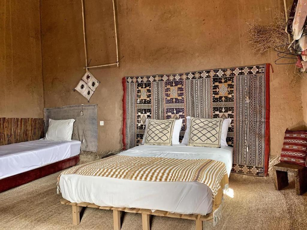 Un ou plusieurs lits dans un hébergement de l'établissement Kasbah Oulad Othmane