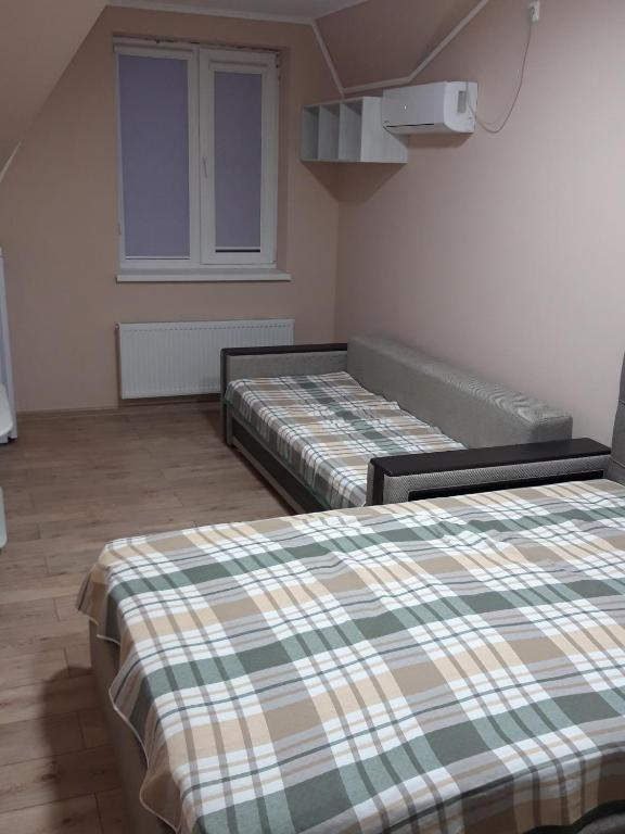 Кровать или кровати в номере Golfstream Hotel