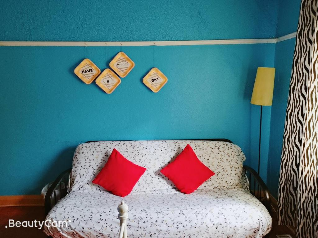 A bed or beds in a room at Kensington Market House