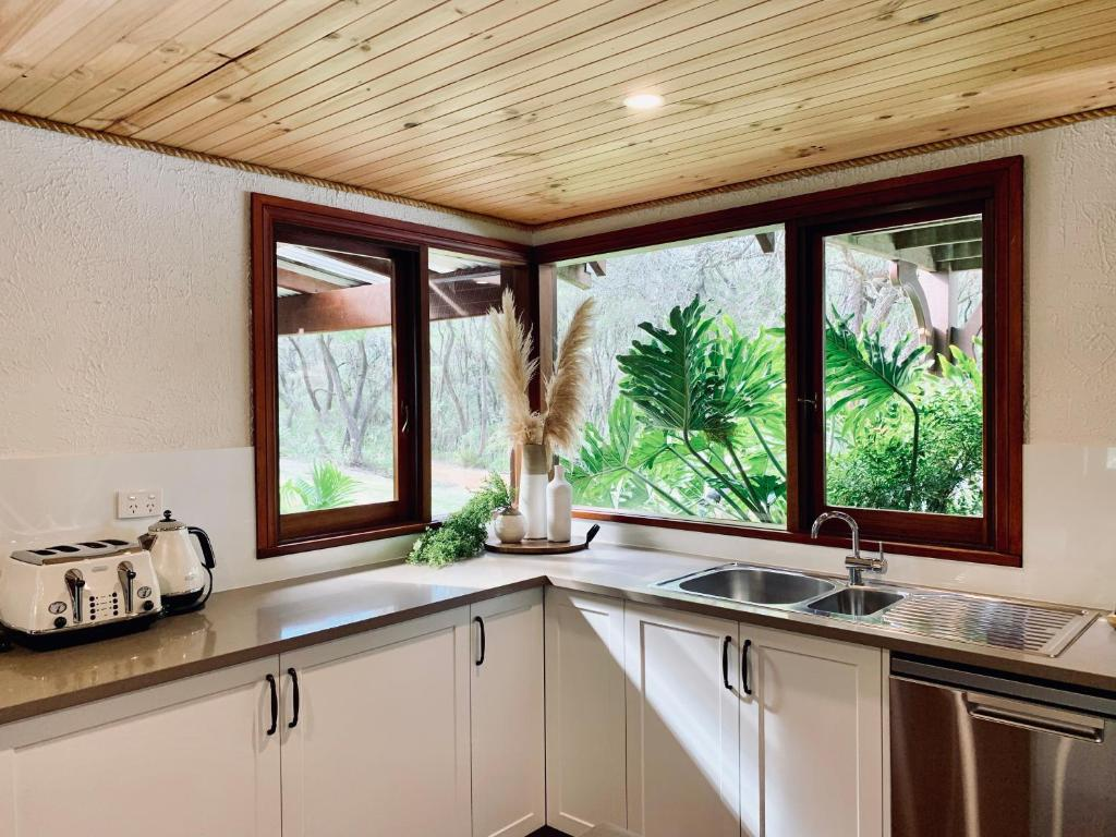 A kitchen or kitchenette at William Bay Cottages