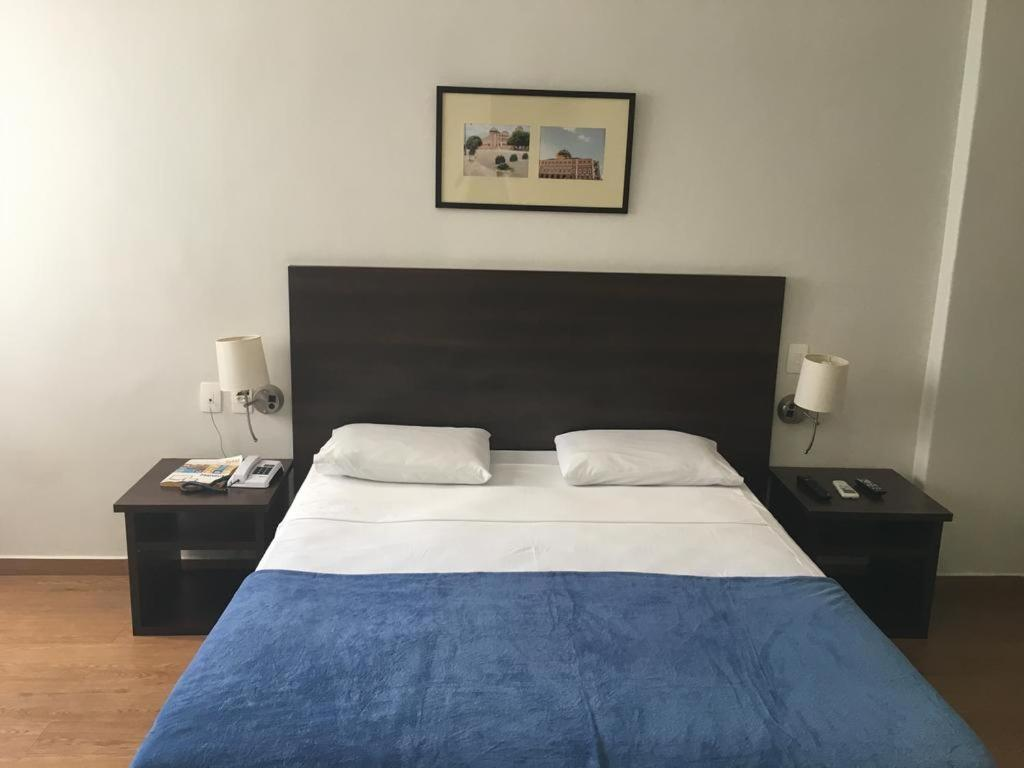 A bed or beds in a room at EcoSuites Hotel Manaus