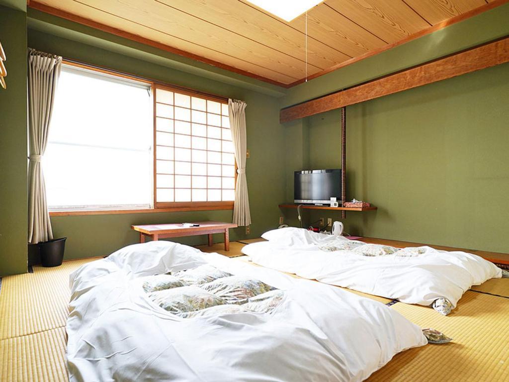 沼口旅館にあるベッド