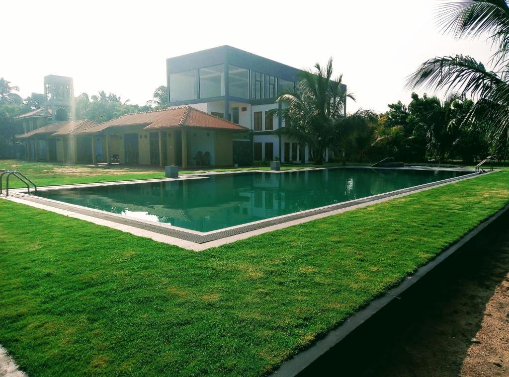 The swimming pool at or near NN Beach Hotel