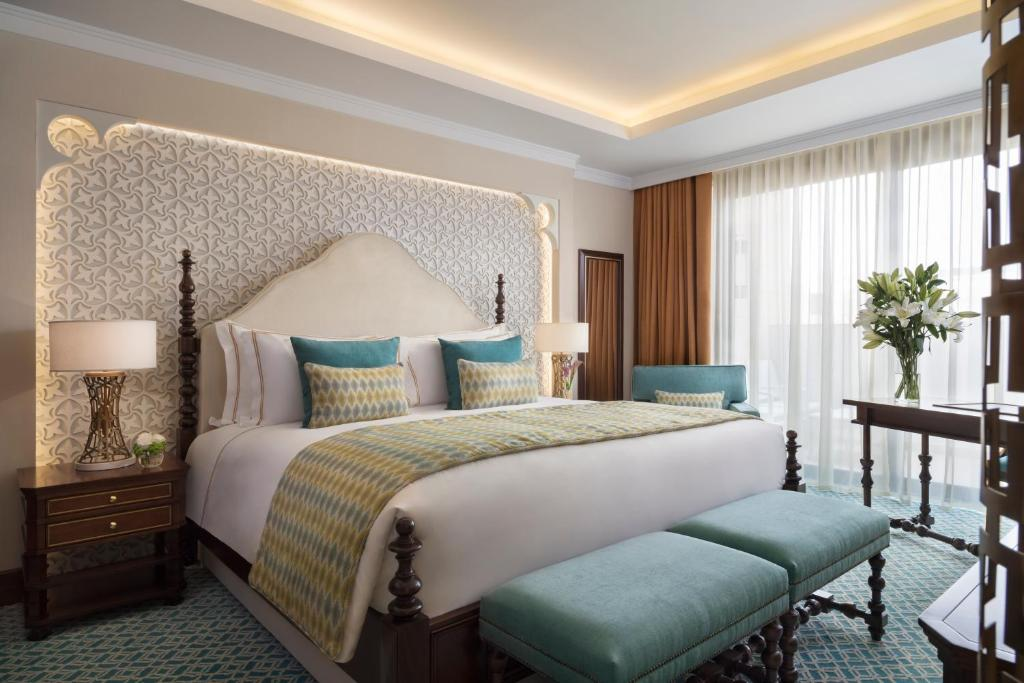 A bed or beds in a room at Al Najada Doha Hotel by Tivoli
