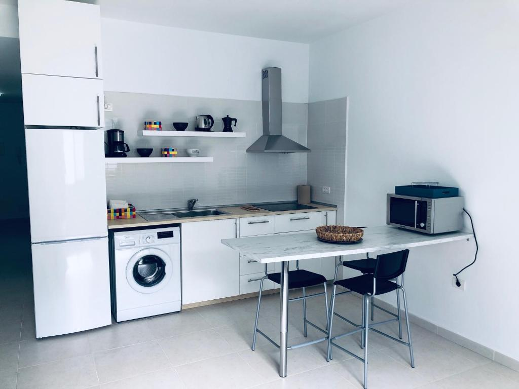 A kitchen or kitchenette at Suite ladybird