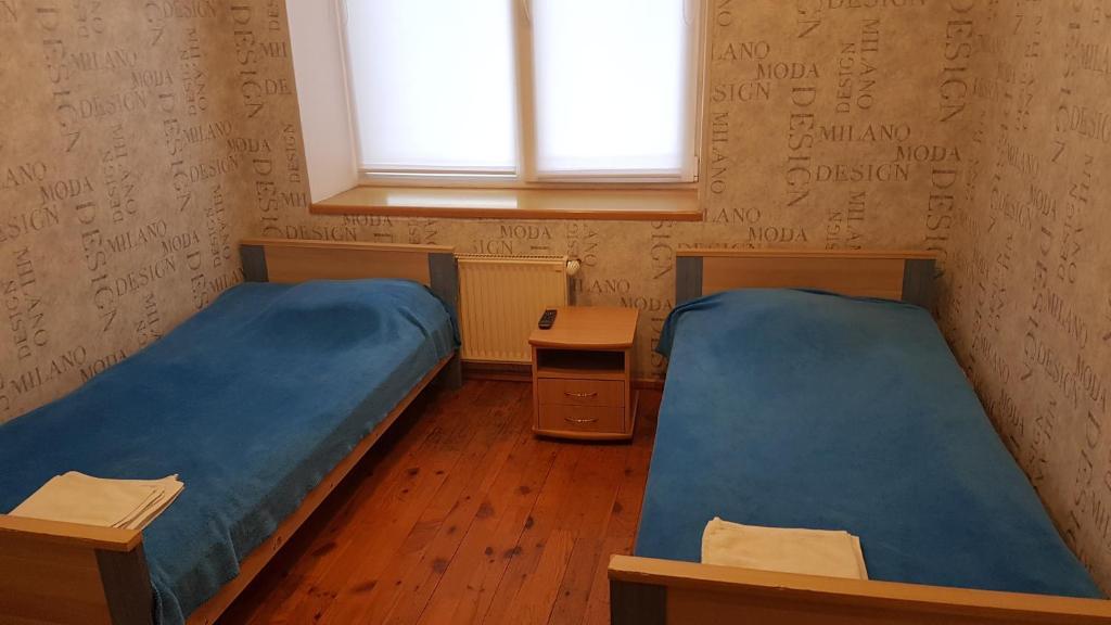Кровать или кровати в номере Hotel Erfolg