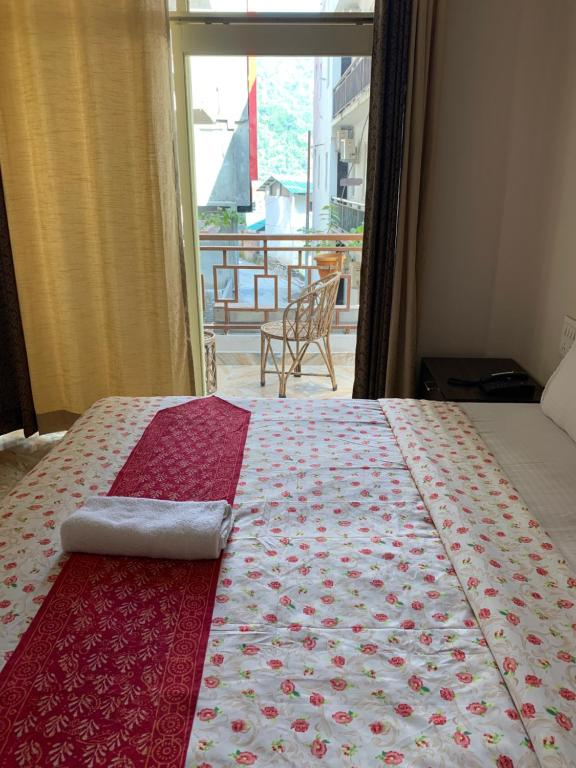 A bed or beds in a room at Rudram Hotel Yoga & Ayurveda Retreat
