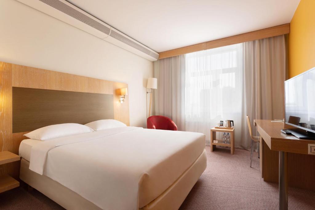 Кровать или кровати в номере Park Inn by Radisson