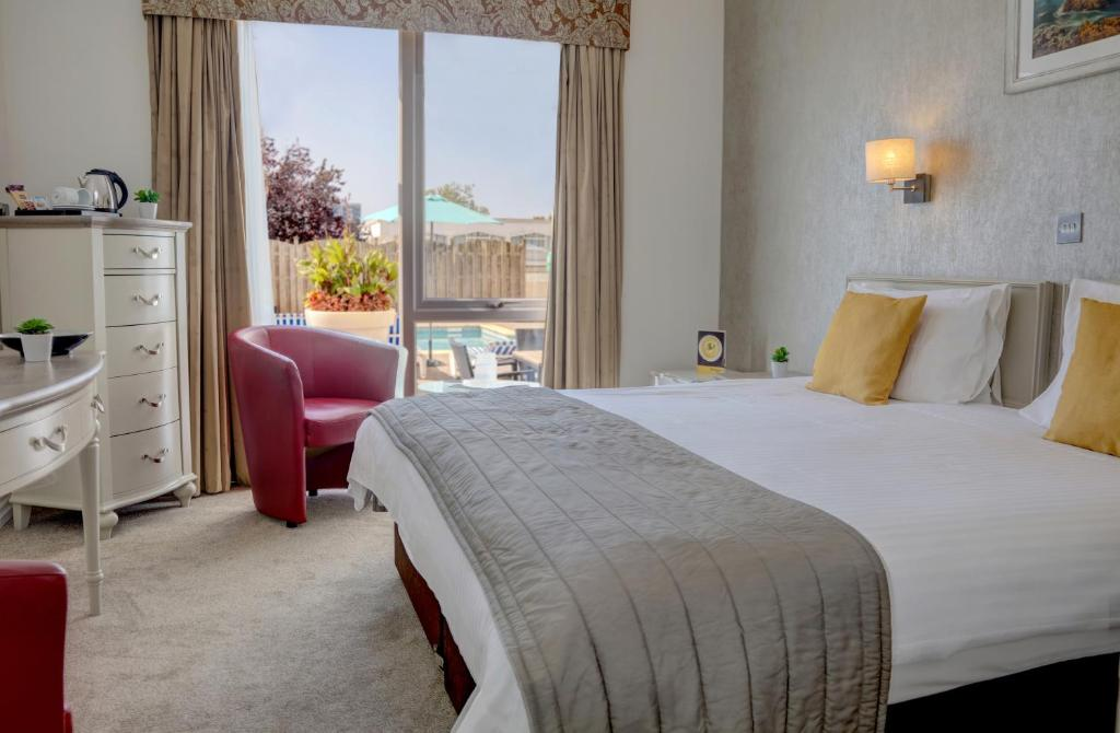 A bed or beds in a room at The Monterey Hotel; Sure Hotel Collection by Best Western