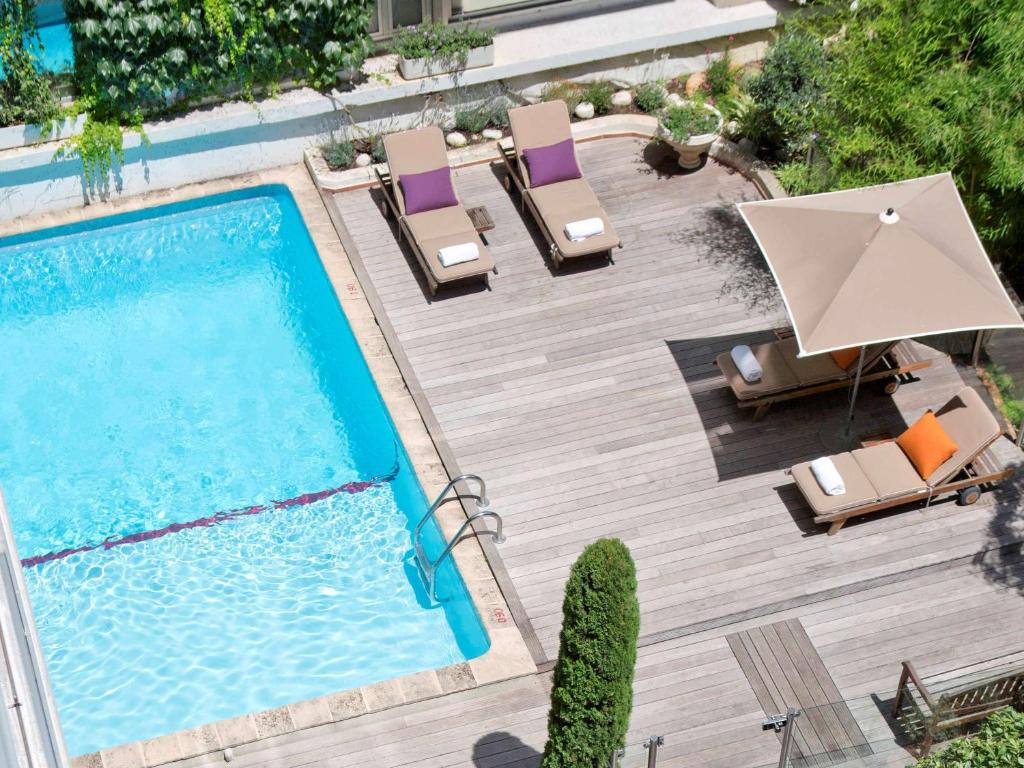 A view of the pool at Hotel Croisette Beach Cannes Mgallery or nearby