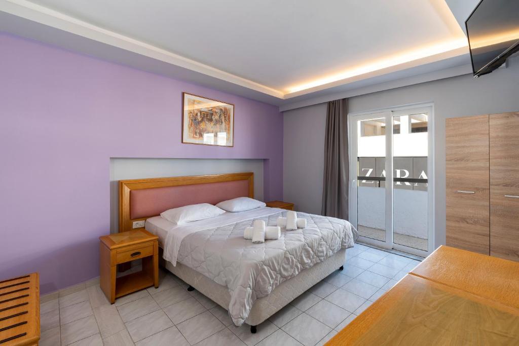A bed or beds in a room at N E P center Hotel Rodos