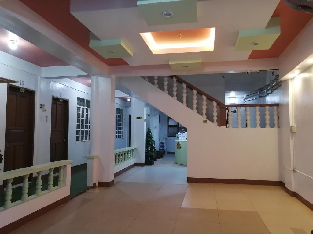 The lobby or reception area at El Moro Beach Resort