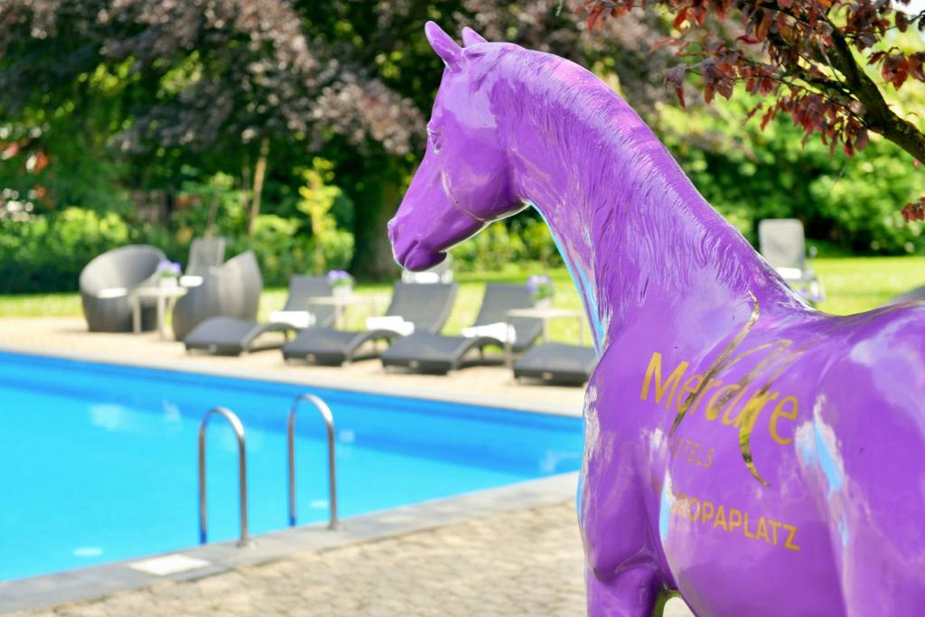 The swimming pool at or close to Mercure Aachen Europaplatz