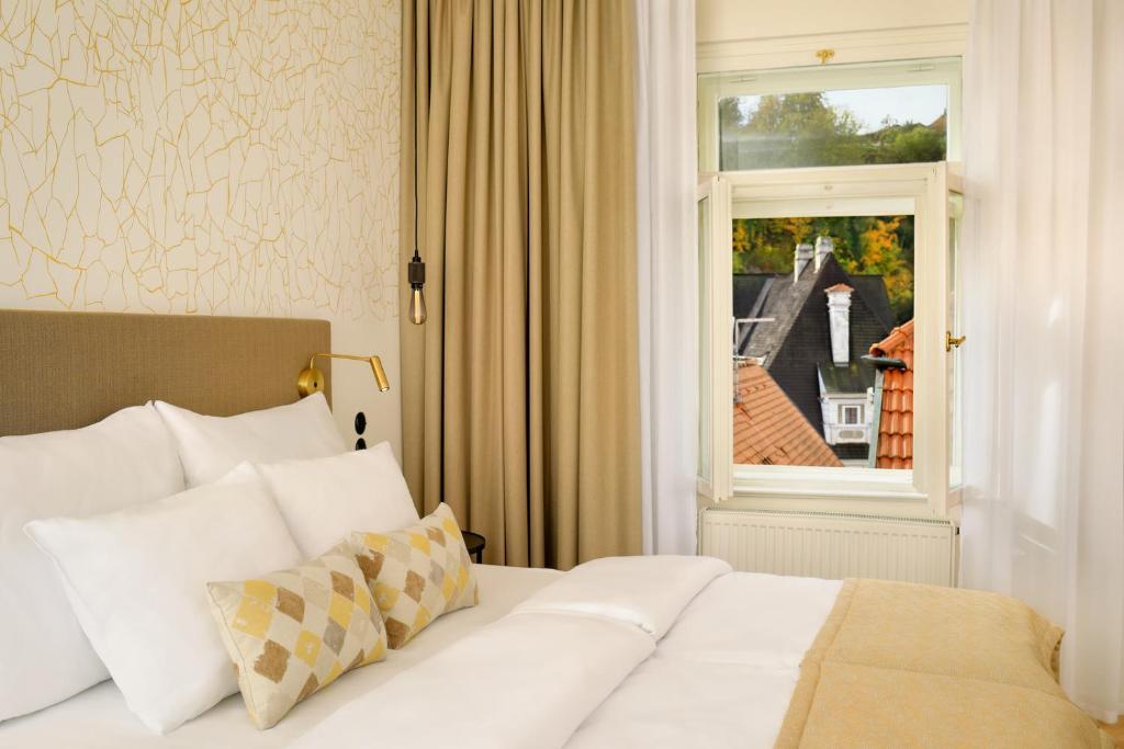 Кровать или кровати в номере Hotel OLDINN