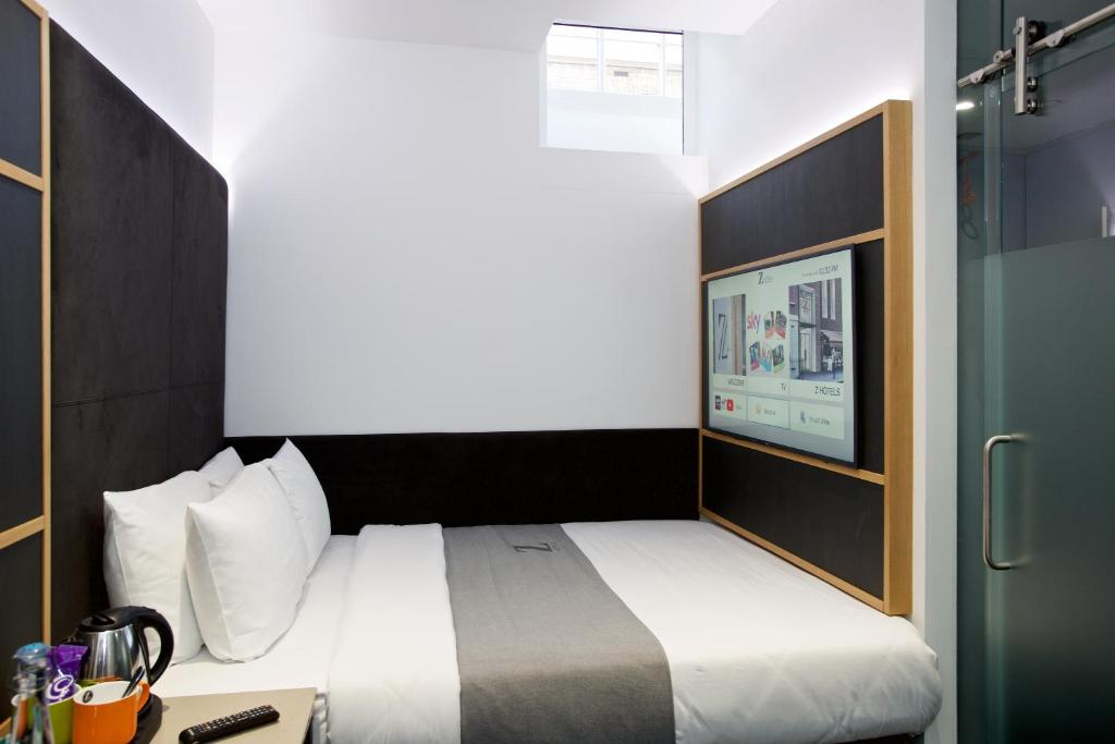 A bed or beds in a room at The Z Hotel Trafalgar