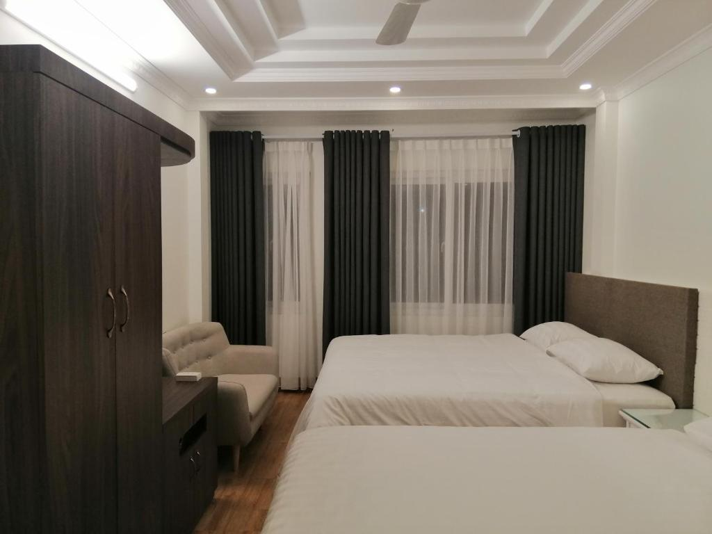 En eller flere senge i et værelse på Sao Mai Cosy Nest-Noi Bai Airport