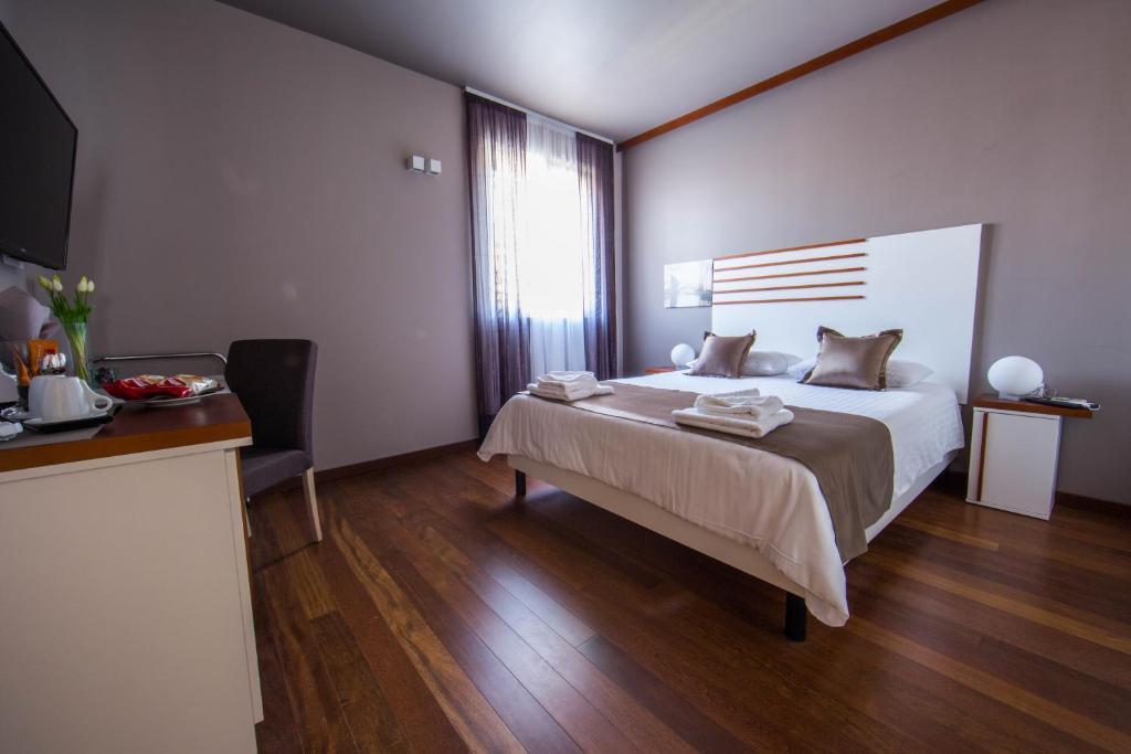 Posteľ alebo postele v izbe v ubytovaní Luxury Rooms Silente Bacvice 1