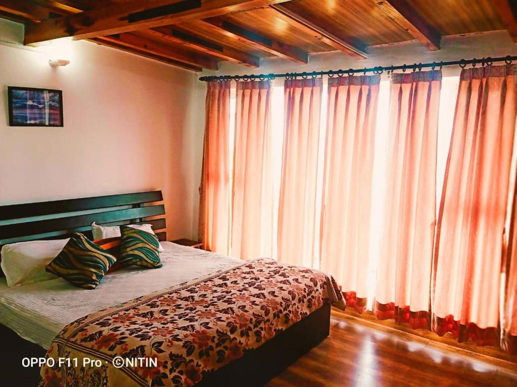A bed or beds in a room at Jaishnavi