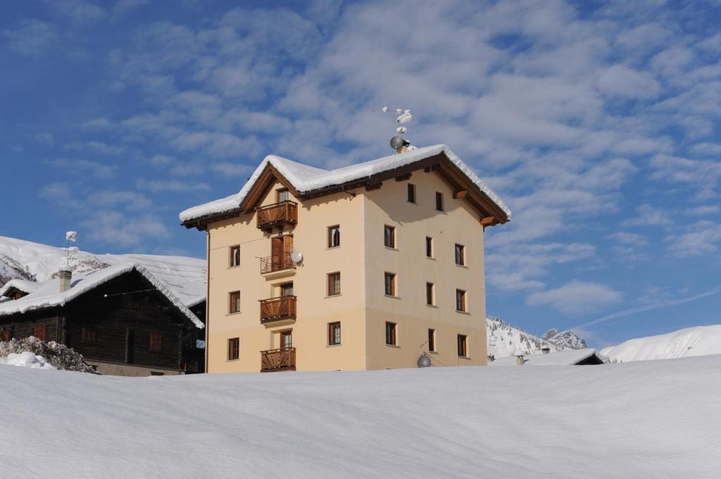 Appartamenti Baita Lumaca v zimě