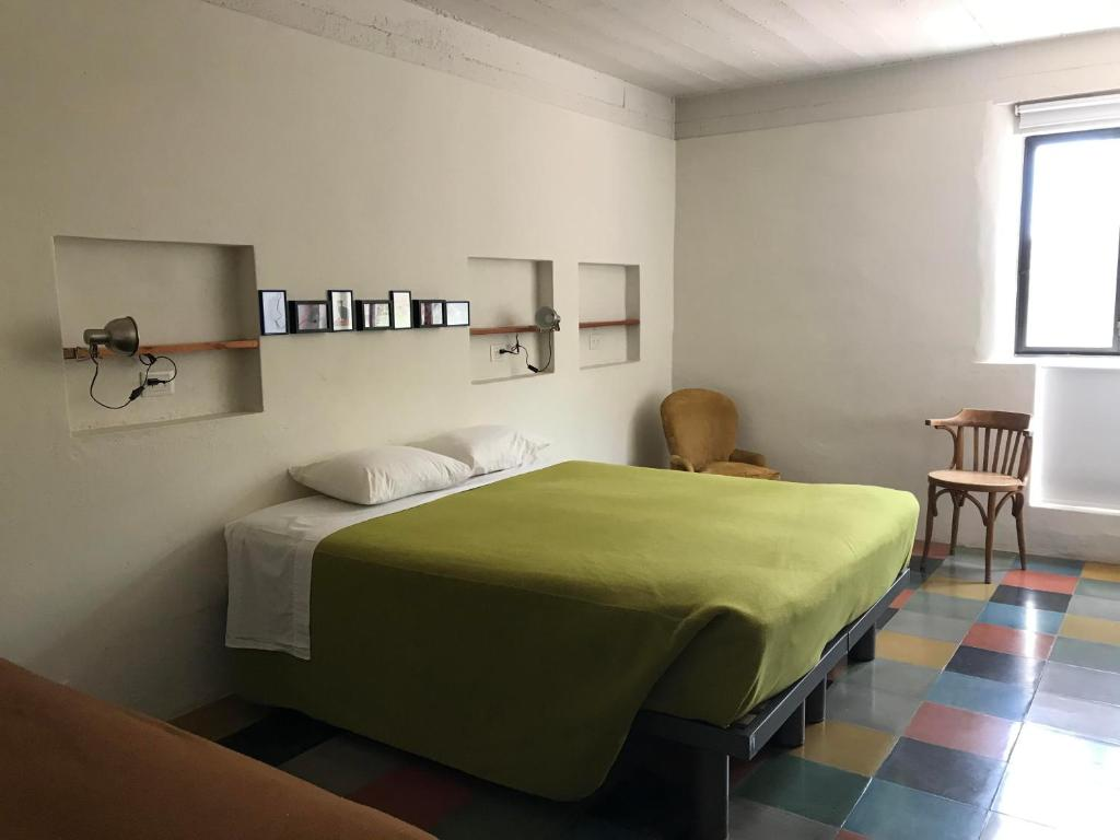 A bed or beds in a room at Patio Alto