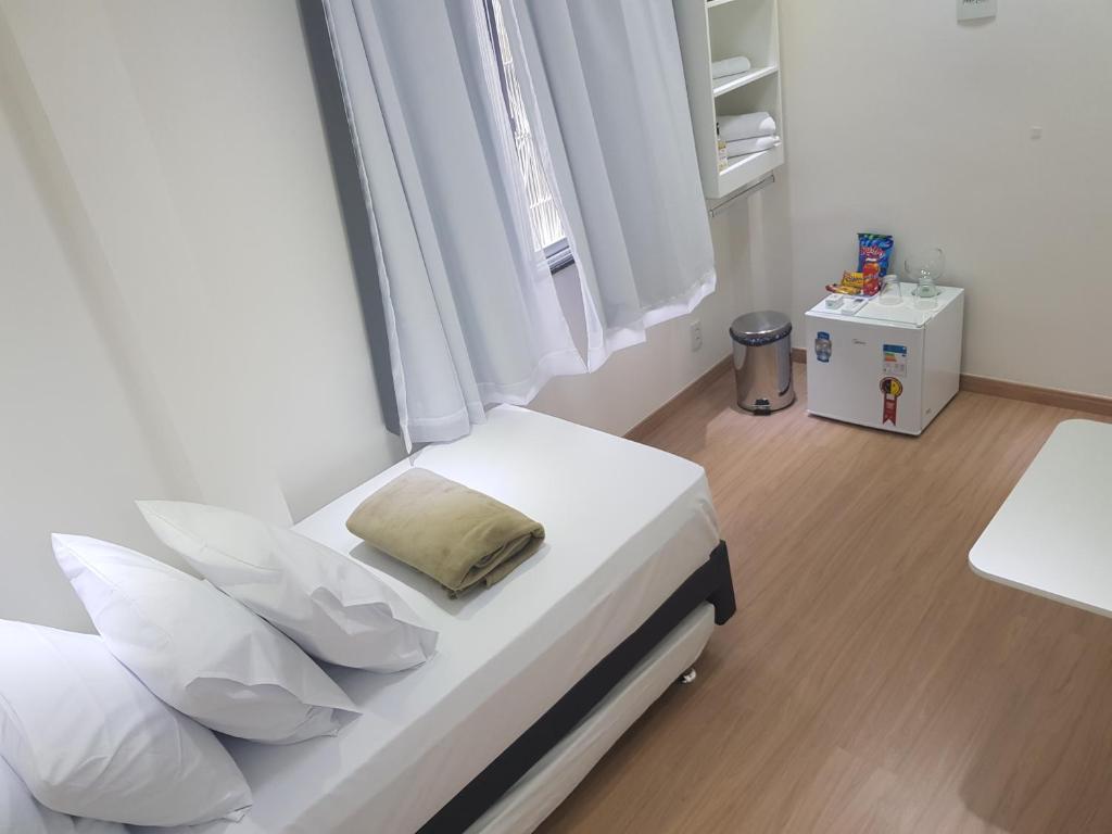 A bed or beds in a room at Quarto Privativo em Condominio