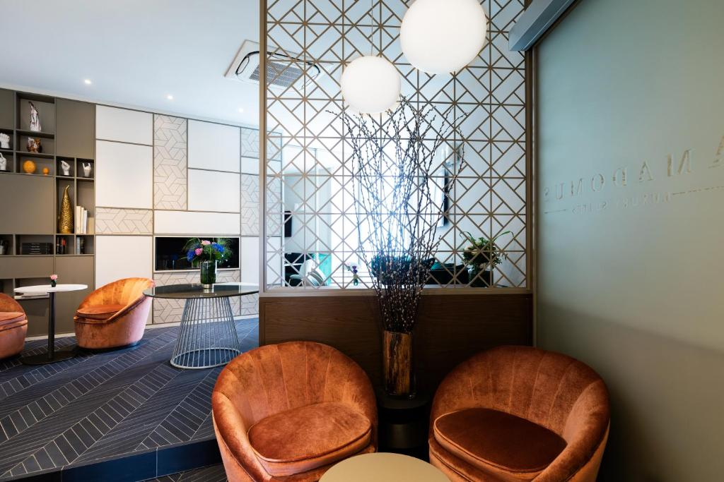 The lobby or reception area at Amadomus Luxury Suites