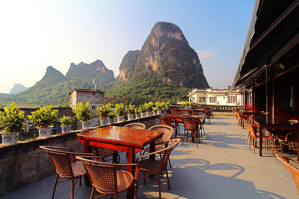 A restaurant or other place to eat at Yangshuo Village Inn