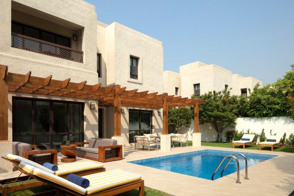 The swimming pool at or near Dubai Creek Club Villas