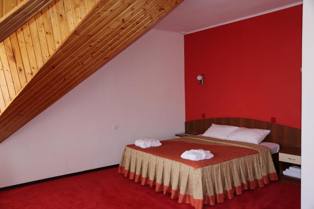 Кровать или кровати в номере Hotel Guamka