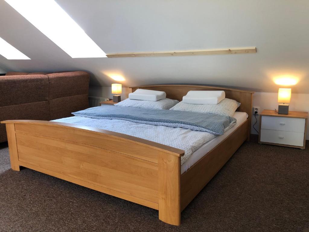 Posteľ alebo postele v izbe v ubytovaní NRC Apartments
