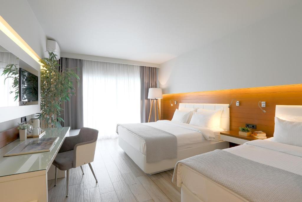 Ένα ή περισσότερα κρεβάτια σε δωμάτιο στο San Panteleimon