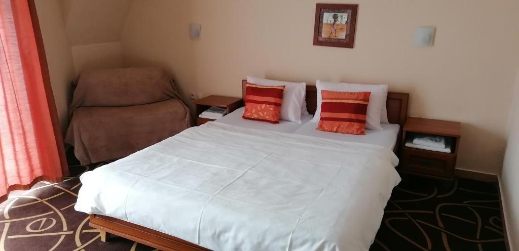 Posteľ alebo postele v izbe v ubytovaní Pension Magnolia
