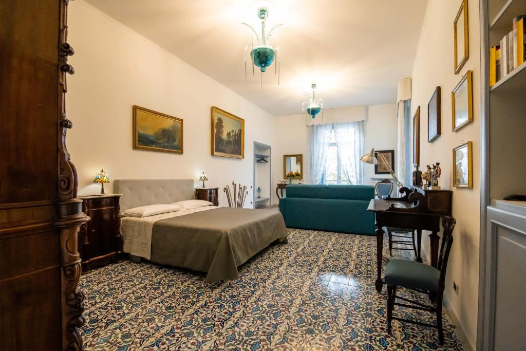 A bed or beds in a room at B&B D'Angleterre